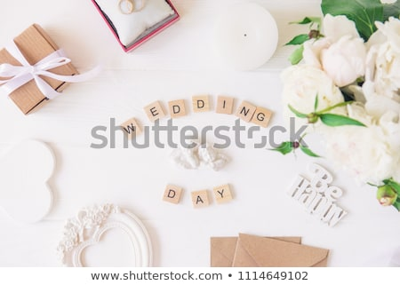 wedding rings with wooden box in the shape of heart stock photo © ruslanshramko