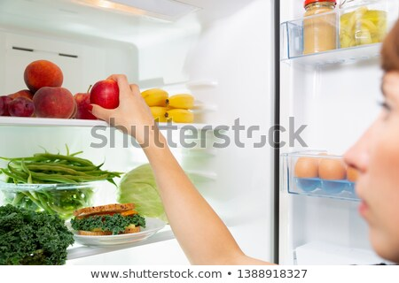 Woman Taking Sandwich From Refrigerator Stock photo © AndreyPopov