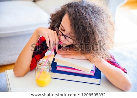 вьющиеся волосы подростка девушка напитки сока книгах Сток-фото © boggy