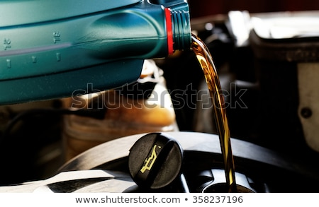 fresh oil being poured during an oil change to a car stock photo © lopolo