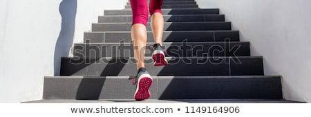 Fit active woman running up stairs in outdoor landscape Stock photo © lovleah