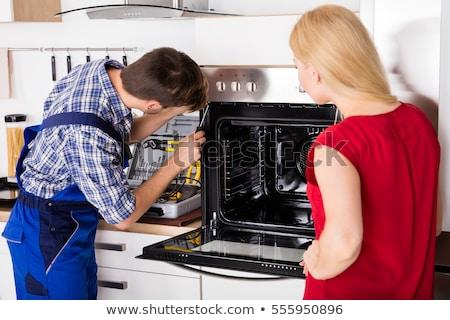Giovani forno cucina sorridere Foto d'archivio © AndreyPopov
