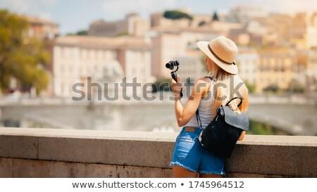 aantrekkelijk · jonge · kaukasisch · vrouw · lopen · buitenshuis - stockfoto © deandrobot