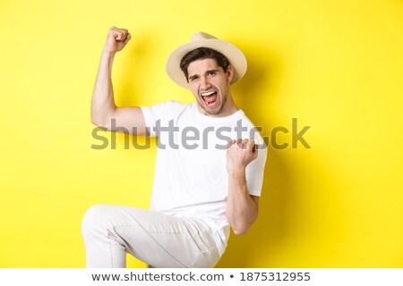 happy friends making fist pump gesture Stock photo © dolgachov