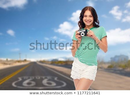 Stock photo: teenage girl with vintage film camera on route 66