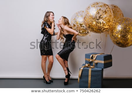 Stunning woman in elegant black dress with Christmas gift. Stock photo © studiolucky