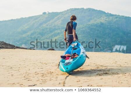молодым человеком байдарках берега человека природы Сток-фото © galitskaya