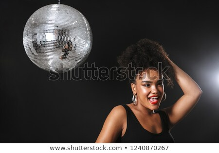 Image of adorable african woman standing with silver disco ball, Stock photo © deandrobot