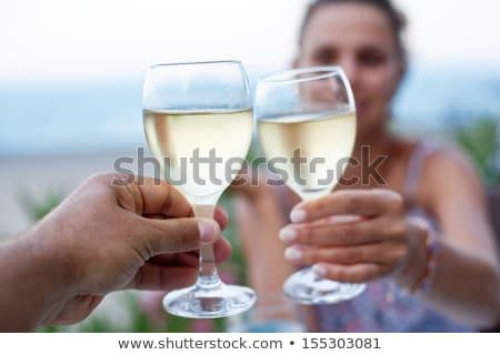 Toast białe wino grupy znajomych Zdjęcia stock © dashapetrenko