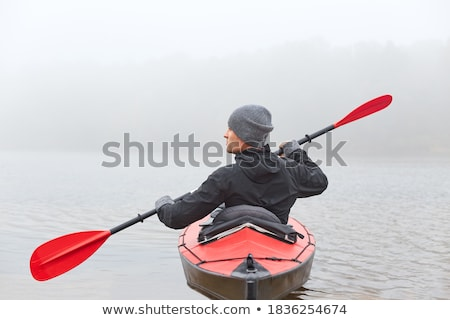 Strong man in canoe Stock photo © jossdiim