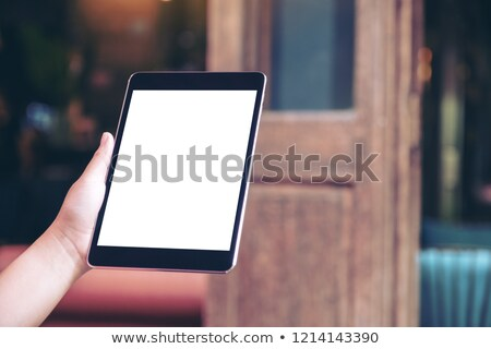 Hand using tablet with copy space Stock photo © ra2studio