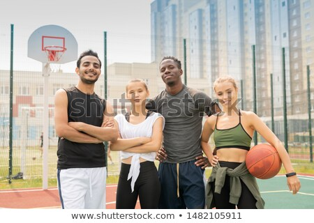 Young cheerful intercultural friends in activewear standing close to one another Stock photo © pressmaster