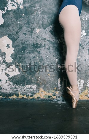 Legs of young ballerina with pointe shoes by the grunge wall Stock photo © boggy
