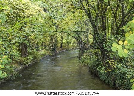 Gyönyörű folyó München zöld fák tájkép Stock fotó © meinzahn