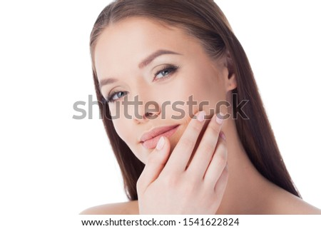Beautiful girl massages her face Stock photo © Nejron