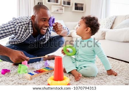 baby · jongen · spelen · speelgoed · gelukkig · maanden - stockfoto © bmonteny