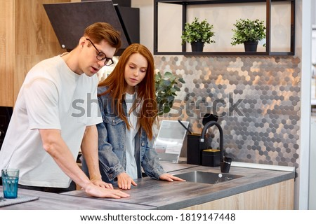 Woman and man shopping for a kitchen and other furniture Stock photo © Kzenon