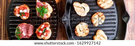 Banner of Toast on grill pan. Set of crostini Stock photo © Illia