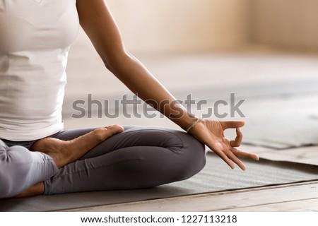 Slim woman meditating in Lotus pose Stock photo © dashapetrenko