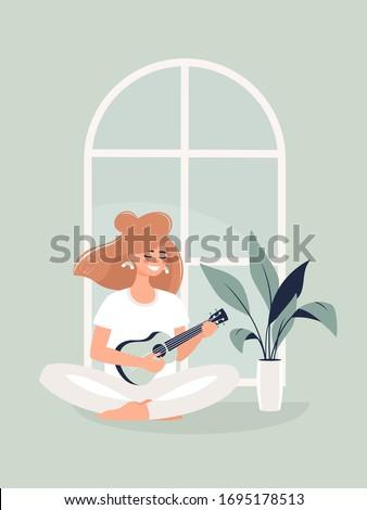Woman Playing the Guitar Stock photo © leedsn