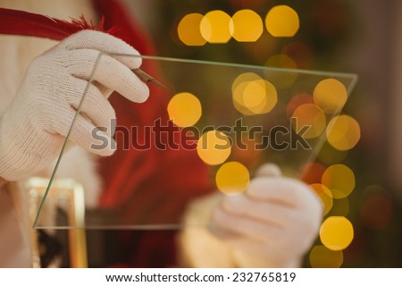 Close up of santa writing list on the glass Stock photo © wavebreak_media