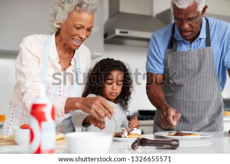 Grandmother with grandfather feeds child stock photo © Paha_L