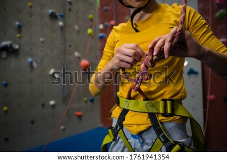 Stock photo: Midsection of female athlete tying rope in health club