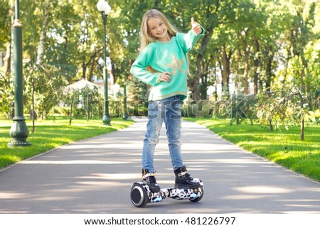 Girl Riding on Segway Personal Transporter in Park Stock photo © robuart
