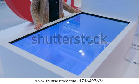 Kezek megérint interaktív asztal férfi lila Stock fotó © ra2studio