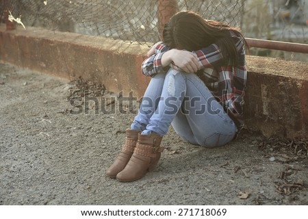 Teen siting on the ground like depress Stock photo © Lopolo