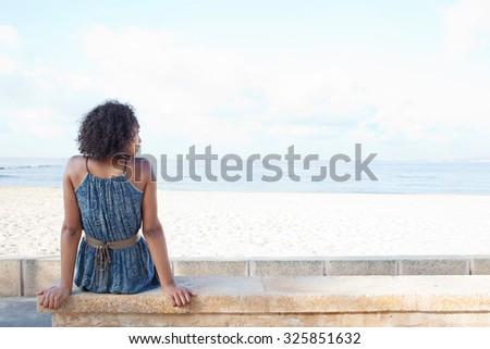 Hátsó nézet gyönyörű fiatal afroamerikai nő ül Stock fotó © wavebreak_media