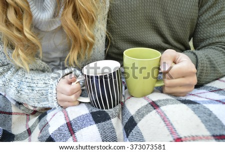 Woman and man on cold winter day warming up with hot tea Stock photo © Kzenon
