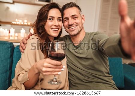Couple having wine Stock photo © Kzenon