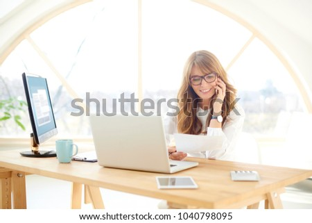 The businesswoman working at her desk  Stock photo © Elnur