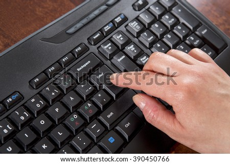 Woman clicking on enter button Stock photo © Minervastock