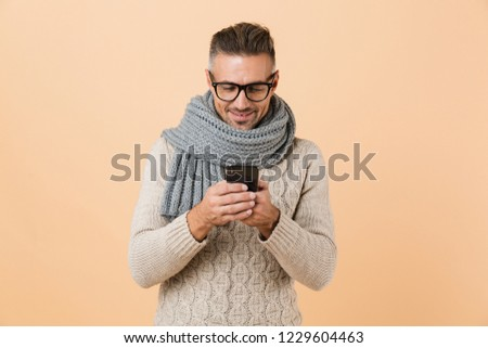 Portrait of a happy young man dressed in sweater Stock photo © deandrobot