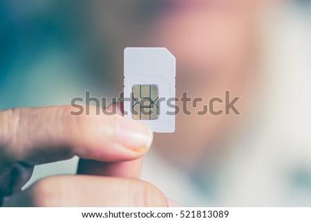 sim card and mobile phone  Stock photo © OleksandrO