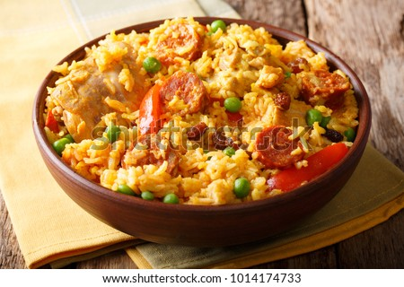 Bowl of chicken and chorizo paella Stock photo © Alex9500