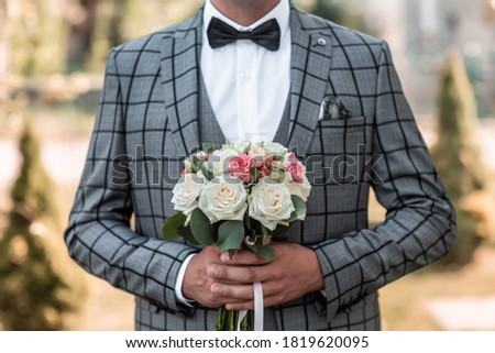 happy man in tuxedo adjusting his bowtie Stock photo © feedough