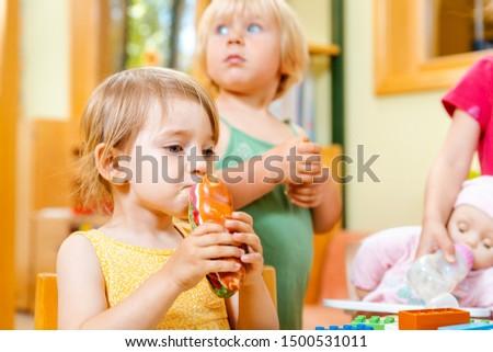 children eating some food in play school stock photo © kzenon