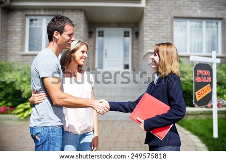 portrait of young couple with realtor in background Stock photo © photography33