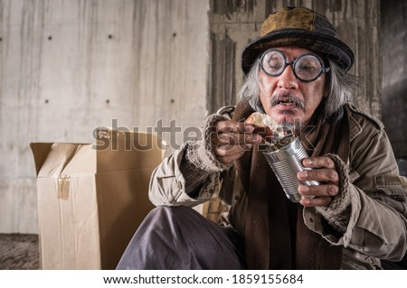man with glasses sitting on the sidewalk in a city Stock photo © feedough