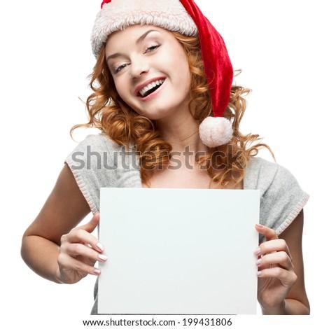 pretty santa girl smiling at camera stock photo © wavebreak_media