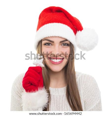 Beautiful brunette in santa hat smiling at camera  Stock photo © wavebreak_media