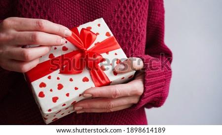Woman unpacking gift. Stock photo © PawelSierakowski