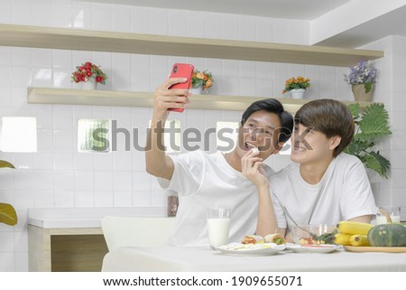 Gay Couple Eating Breakfast Taking Selfie With Phone Stock photo © diego_cervo