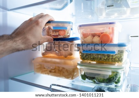 Stock photo: Man's Hand Taking Container Of Mixed Vegetables