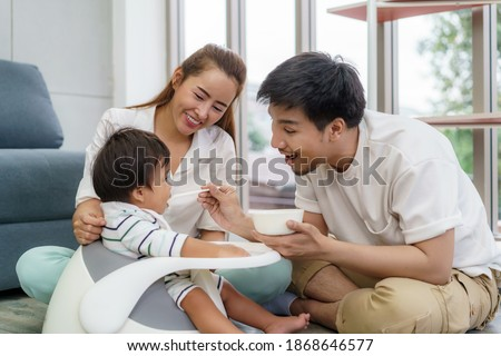Stock photo: father is spooning with his happy smiling son