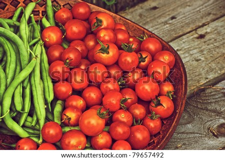 Small tomatoes and green beans  Stock photo © elxeneize