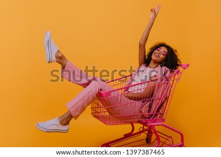 pretty young lady at shopping Stock photo © balasoiu